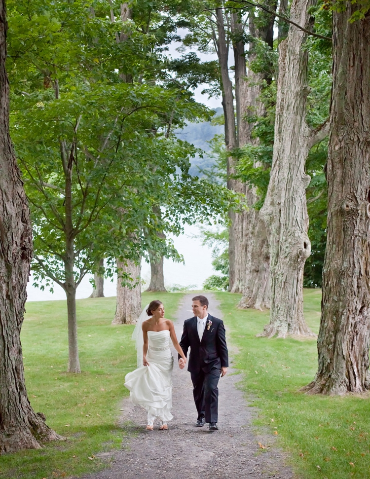 Couple walking on a path on Otsego Lake
