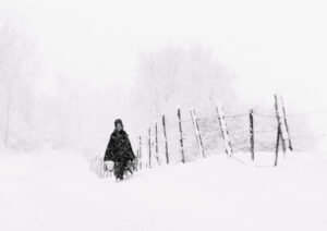 Amish girl in snowstorm